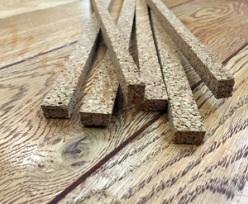 Разновидности порожка: как скрыть стык между покрытиями?